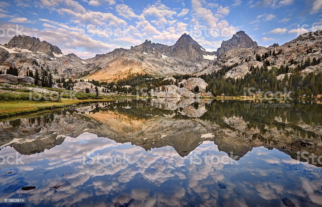 Banner and Ritter Reflected in Lake Ediza stock photo