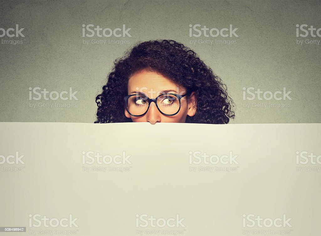 Banner sign woman peeking over edge of blank empty billboard stock photo