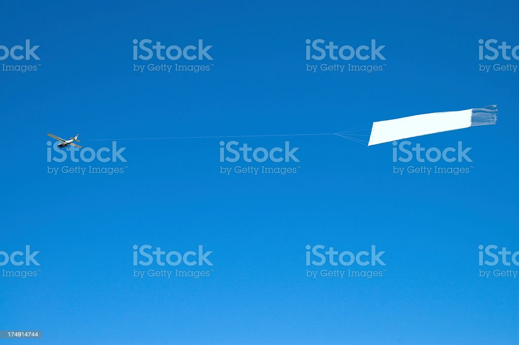 Banner Towing Airplane stock photo