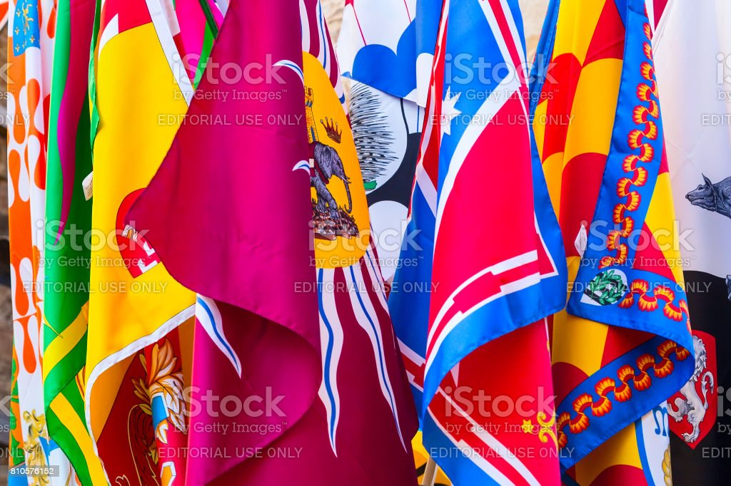Banners flags of the Contrade in Siena, Tuscany, Italy stock photo