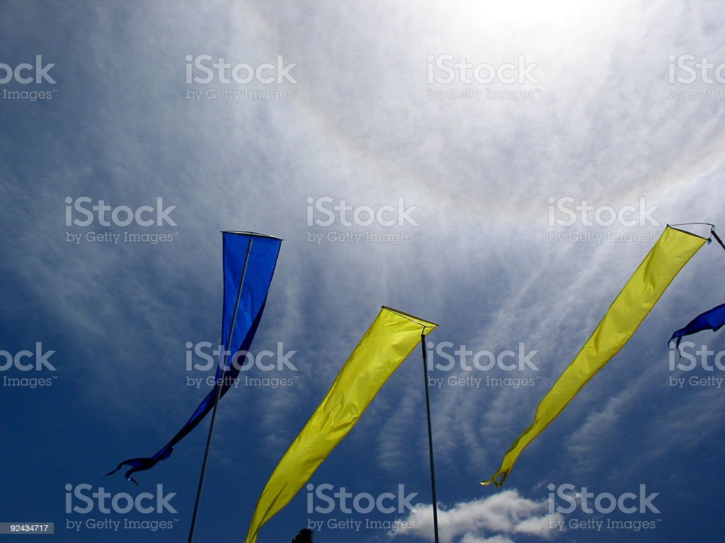 Banners flying against a sun halo royalty-free stock photo
