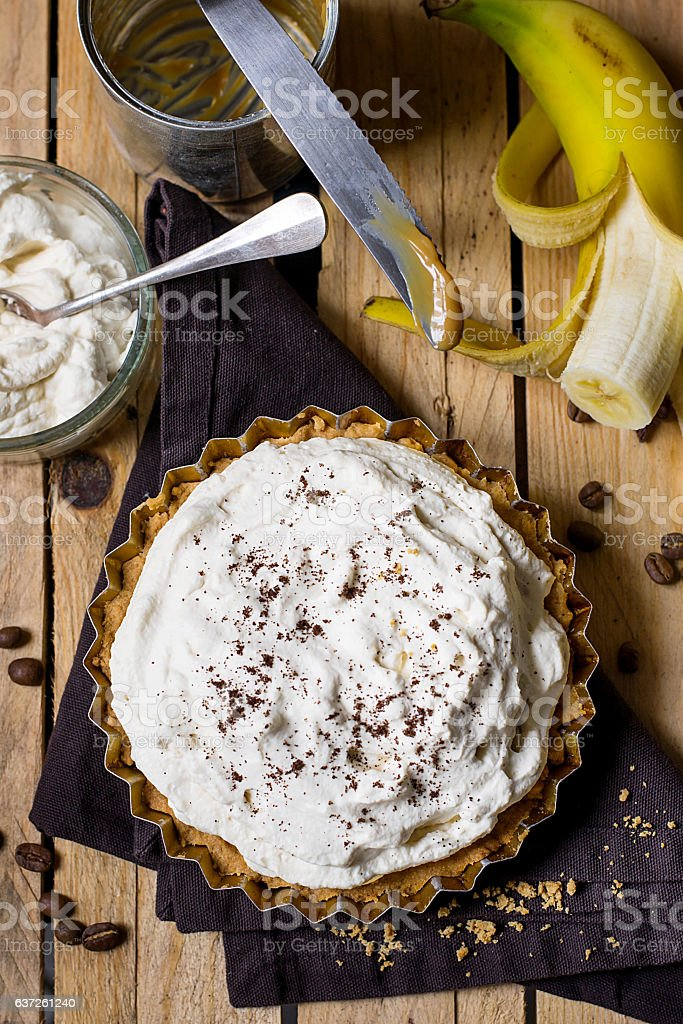 Banoffee pie with bananas, whipped cream and toffee stock photo