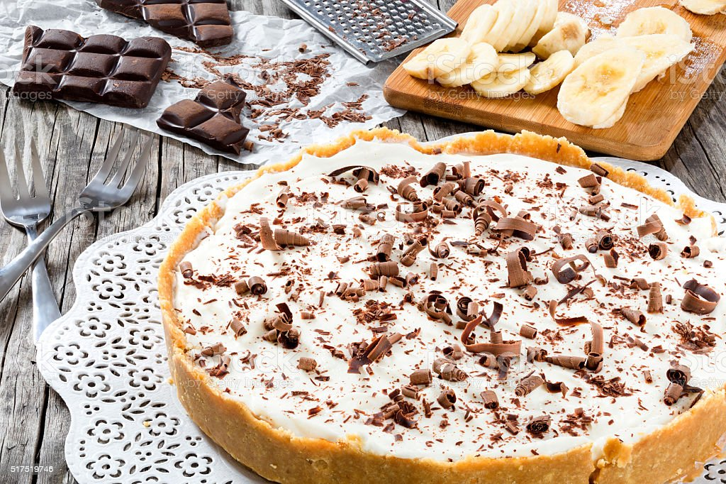 banoffee with banana, decorated by chocolate, authentic english dessert, close-up stock photo
