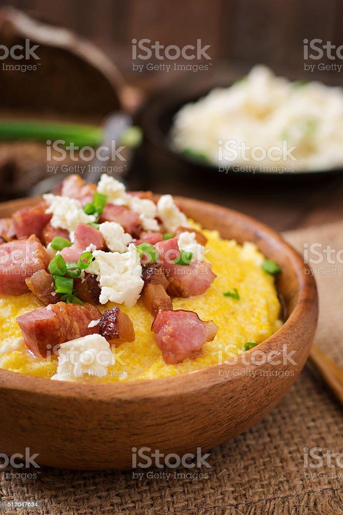 Banosh - Ukrainian Hutsul meal (maize porridge) with bacon stock photo