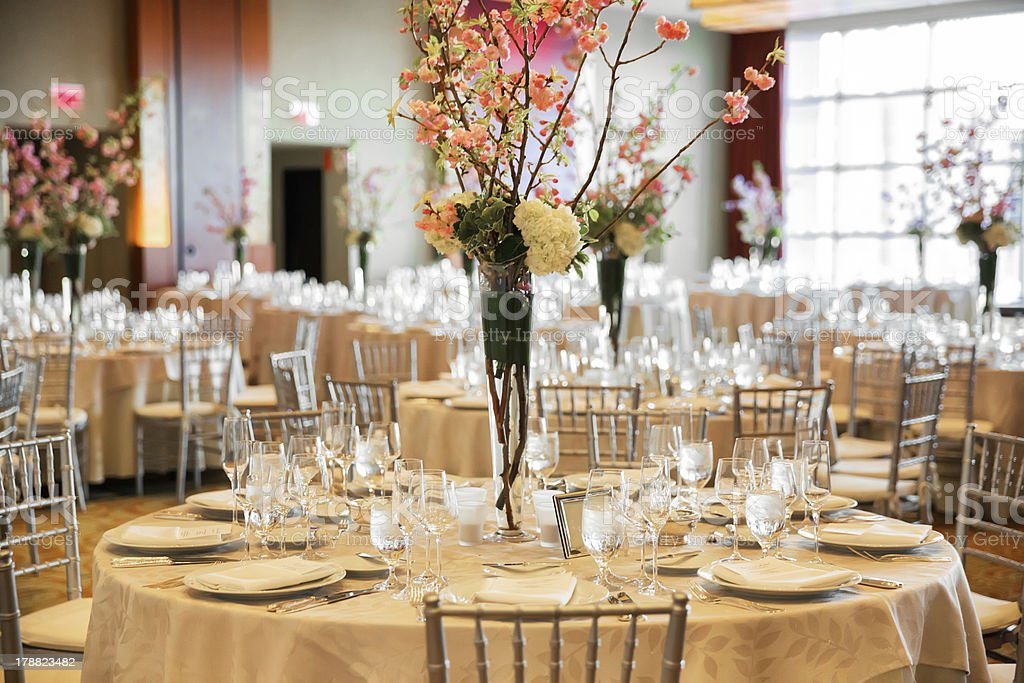 Banquet hall set for a reception royalty-free stock photo