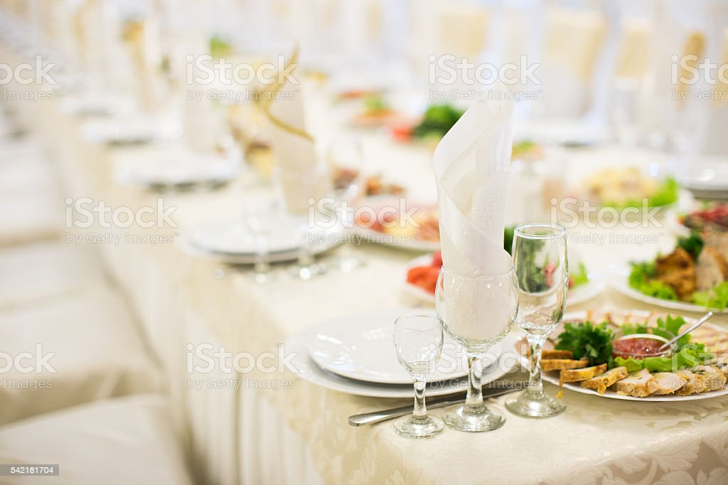 Banquet table setting glass on evening reception stock photo