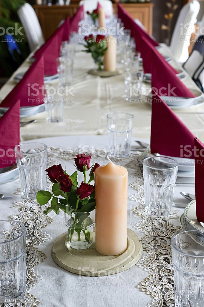 Banquet table setting themed with roses royalty-free stock photo