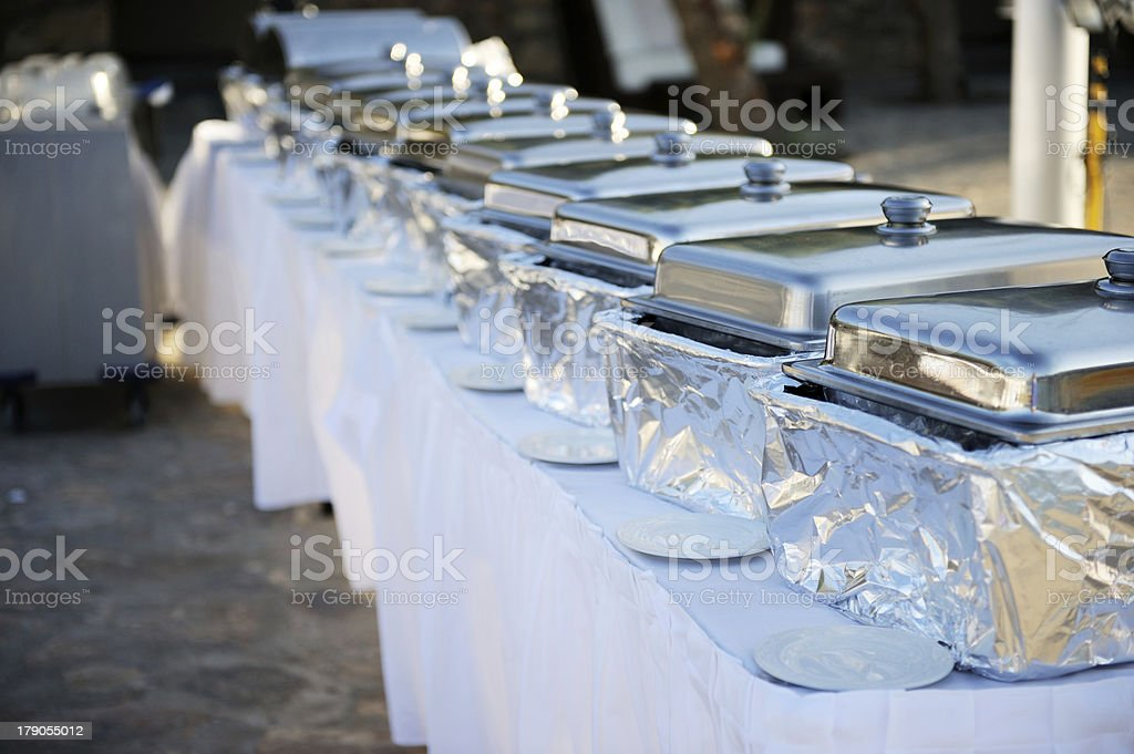Banquet table with chafing dishes stock photo