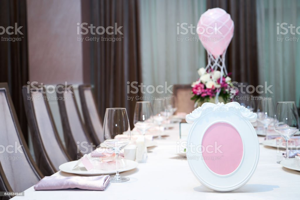 Banquet wedding table setting on evening reception with name card stock photo