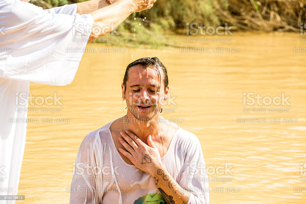 Baptism in a river of Jordan, Israel stock photo