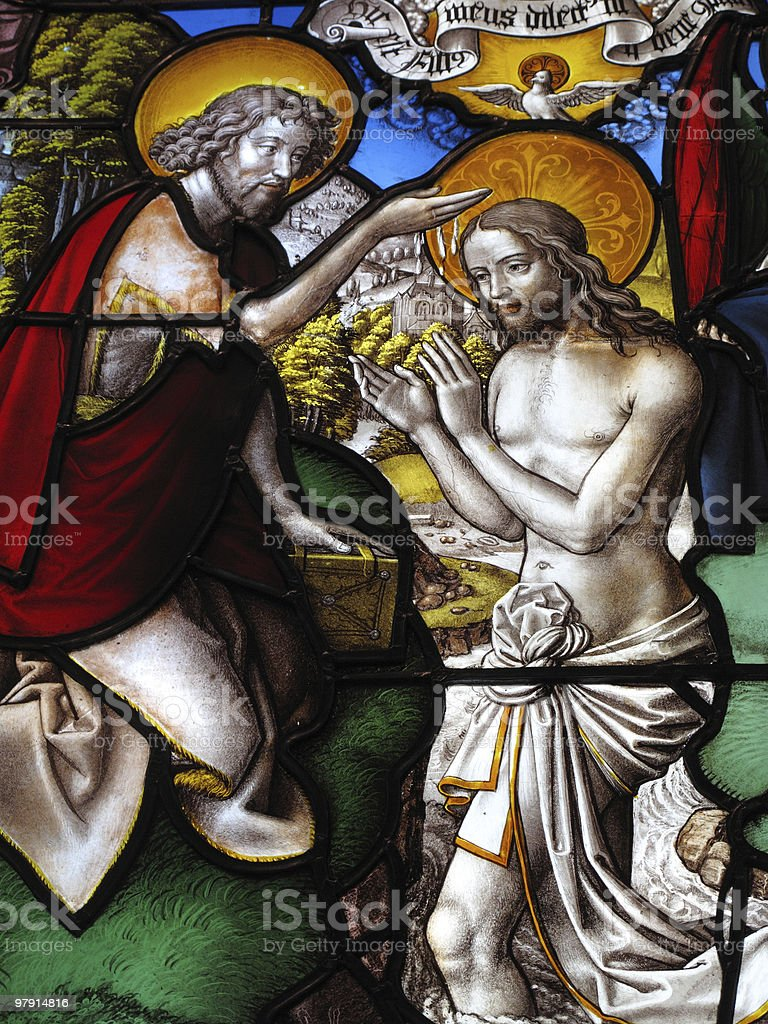Baptism Of Christ On A Medieval Stained Glass Window stock photo