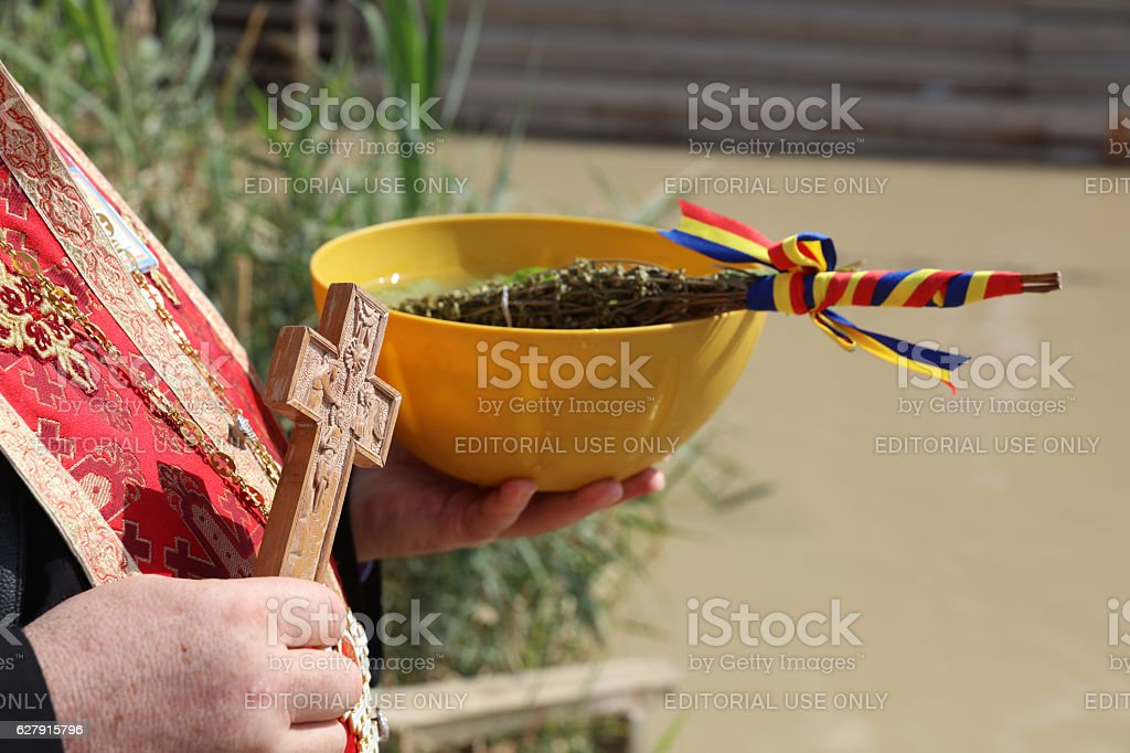 Baptist with Equipment at River Jordan (Qasr el Yahud). Israel stock photo