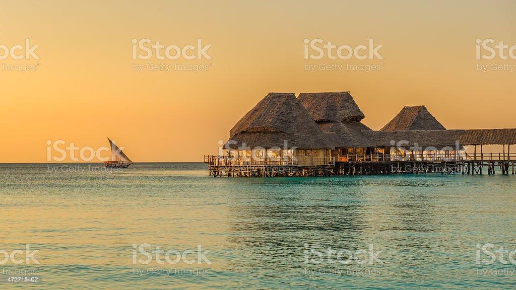 Bar and cafe on water at sunset in Zanzibar, Tanzania stock photo