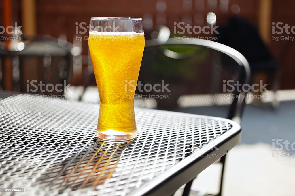 Bar Beer Glass on an Outside Pub Patio Table royalty-free stock photo