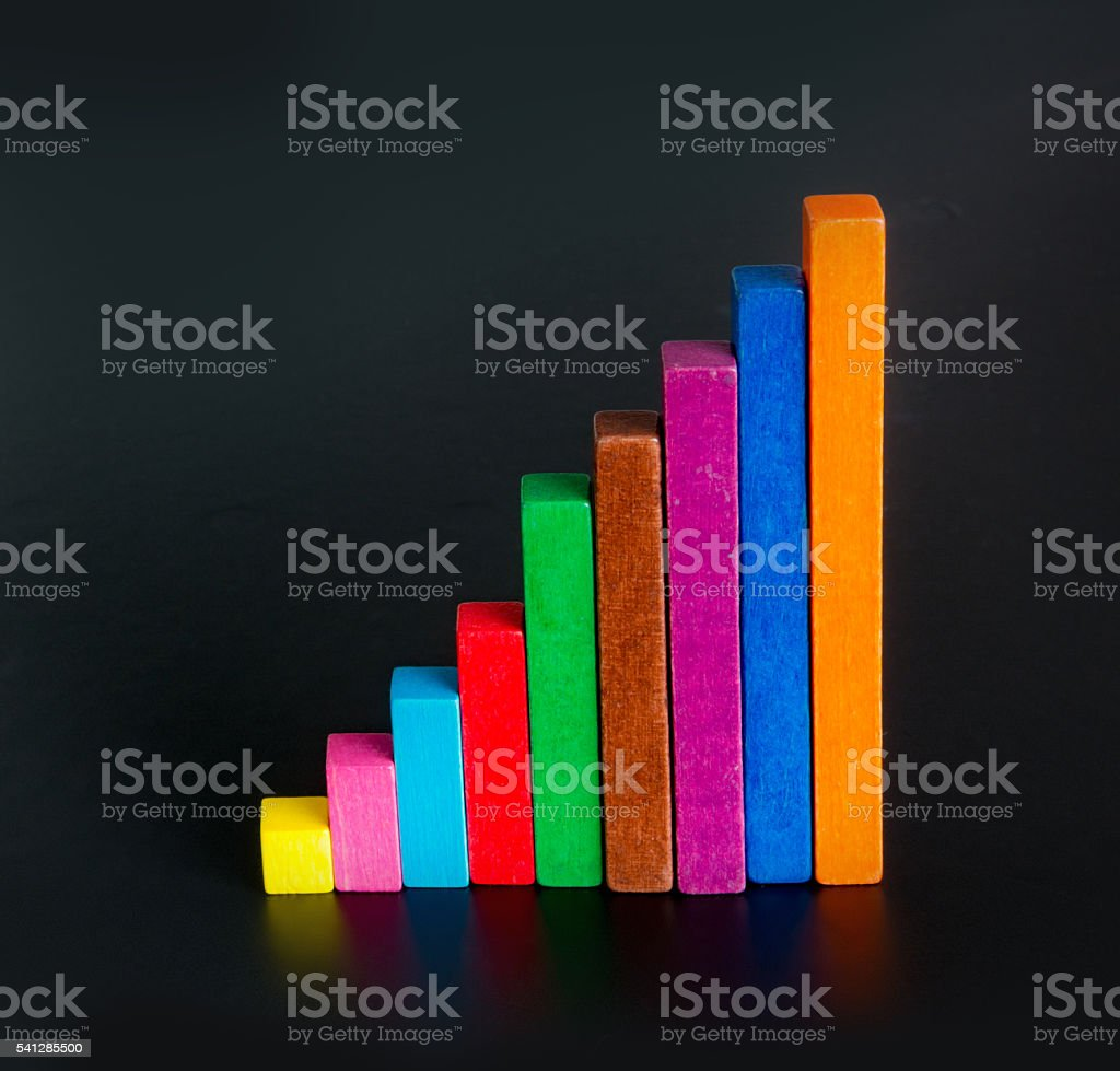 Bar chart  colorful growth made of wood stock photo