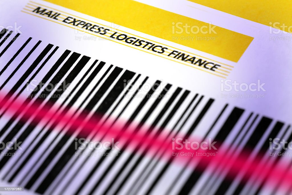 Bar code on parcel with laser beam royalty-free stock photo