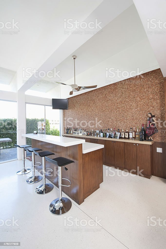 Bar Counter And Bottles With High Ceiling stock photo