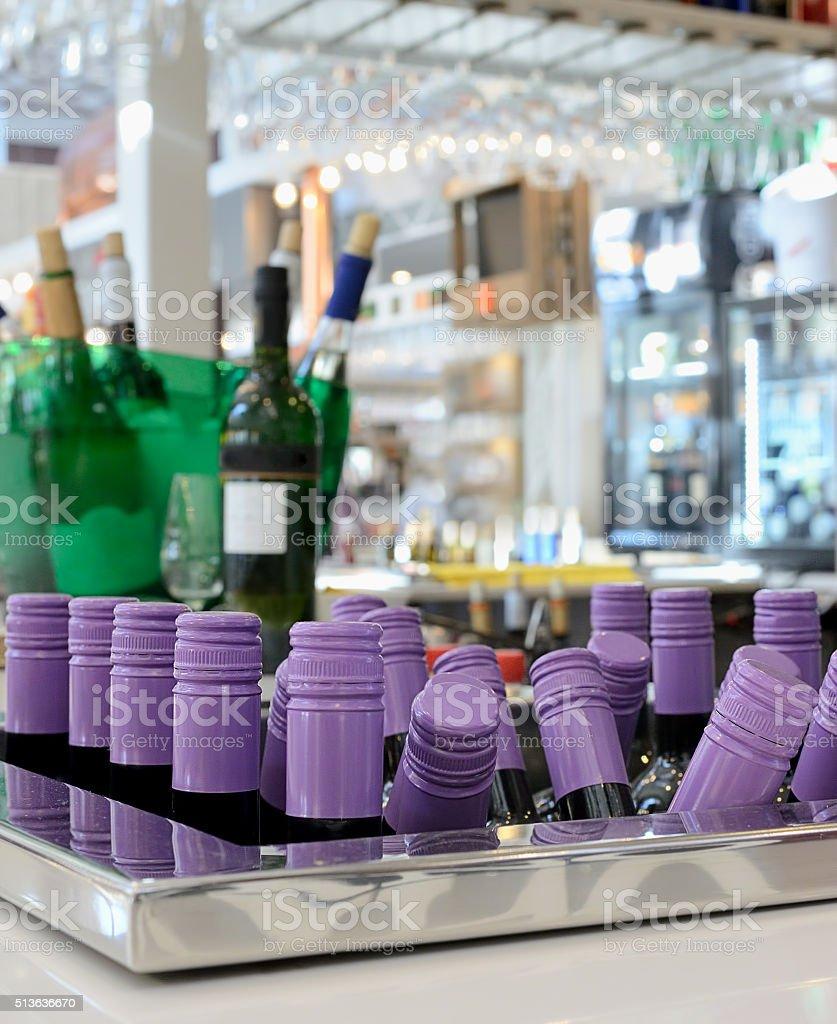 Bar counter, wine bottles in ice buckets, stock photo
