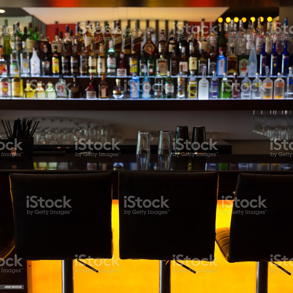 bar counter with chairs in lounge pub cafe stock photo