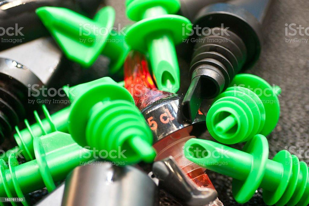 bar equipment - Ausgießer und Ausgießhilfen für Schnaps stock photo