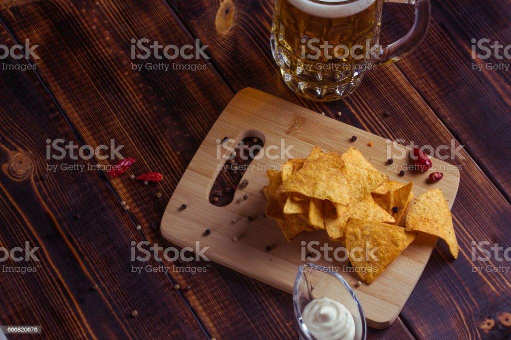 Bar. Fresh, sharp nachos with cheese sauce. stock photo