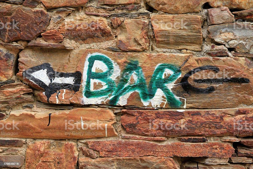Bar Indication in  Stone Wall - Indicacion  Bar en  Pared stock photo