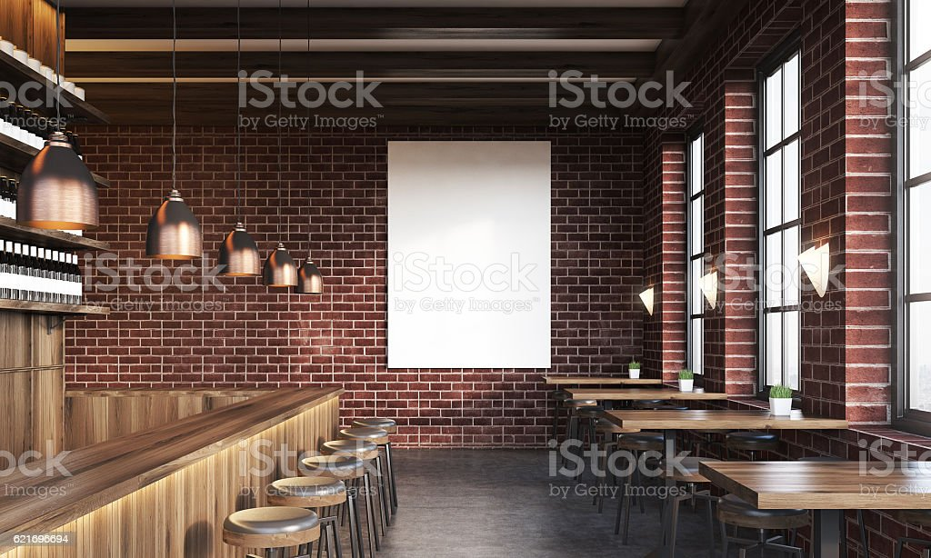 Bar interior with poster and stools stock photo