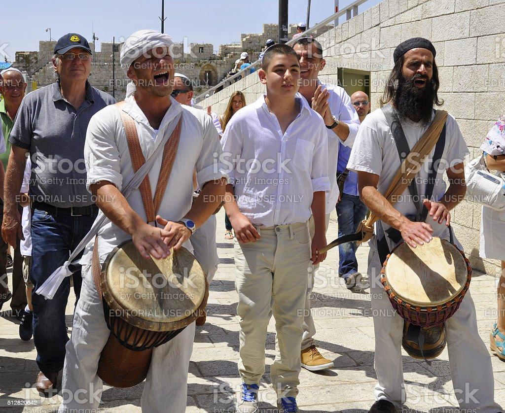Bar Mitzvah boy walks towards the Western Wall in Jerusalm stock photo