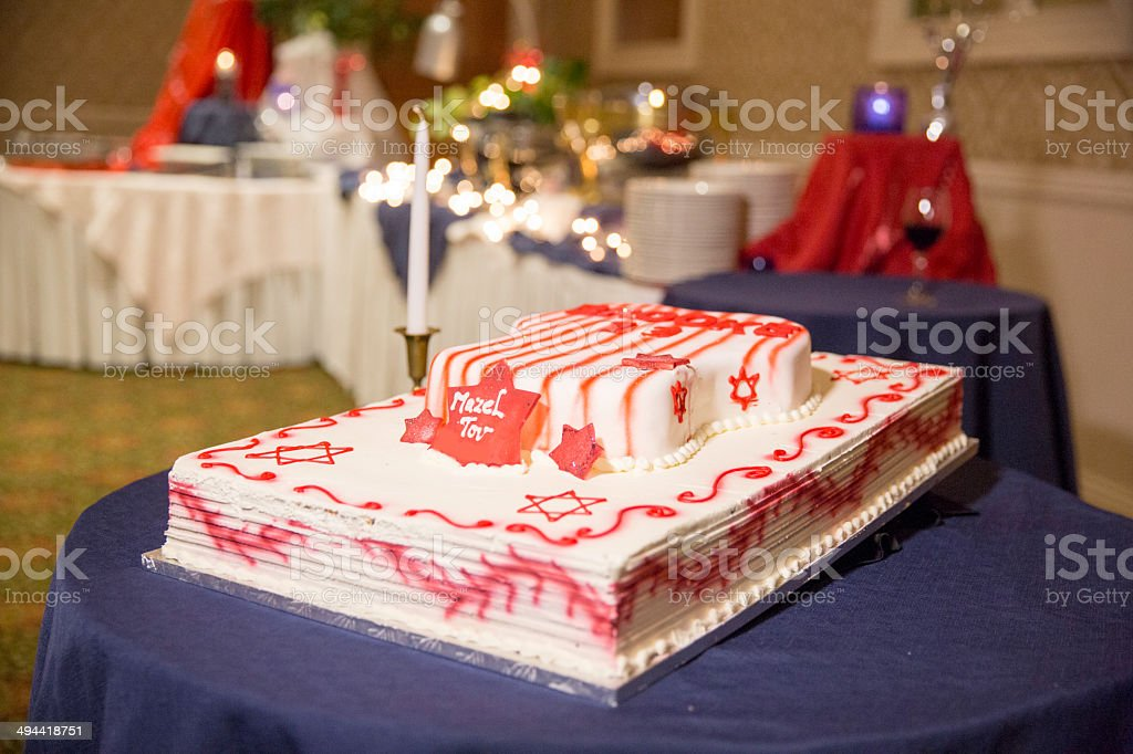 Bar mitzvah cake with one candle and Judaic decorations stock photo