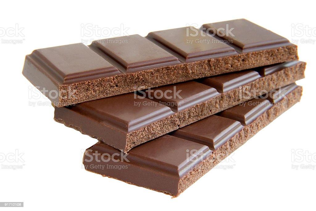 Bar of chocolate broken into three pieces royalty-free stock photo