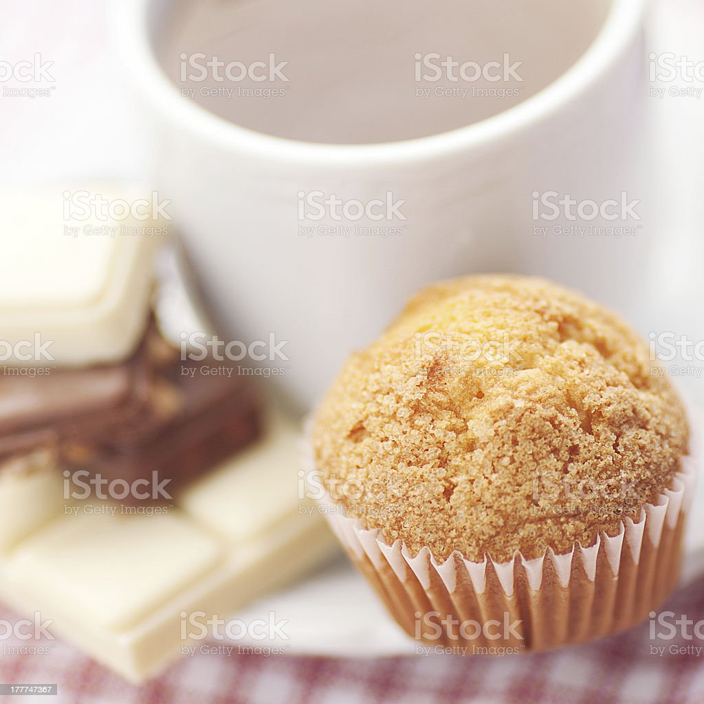 bar of chocolate,tea and muffin on plaid fabric royalty-free stock photo