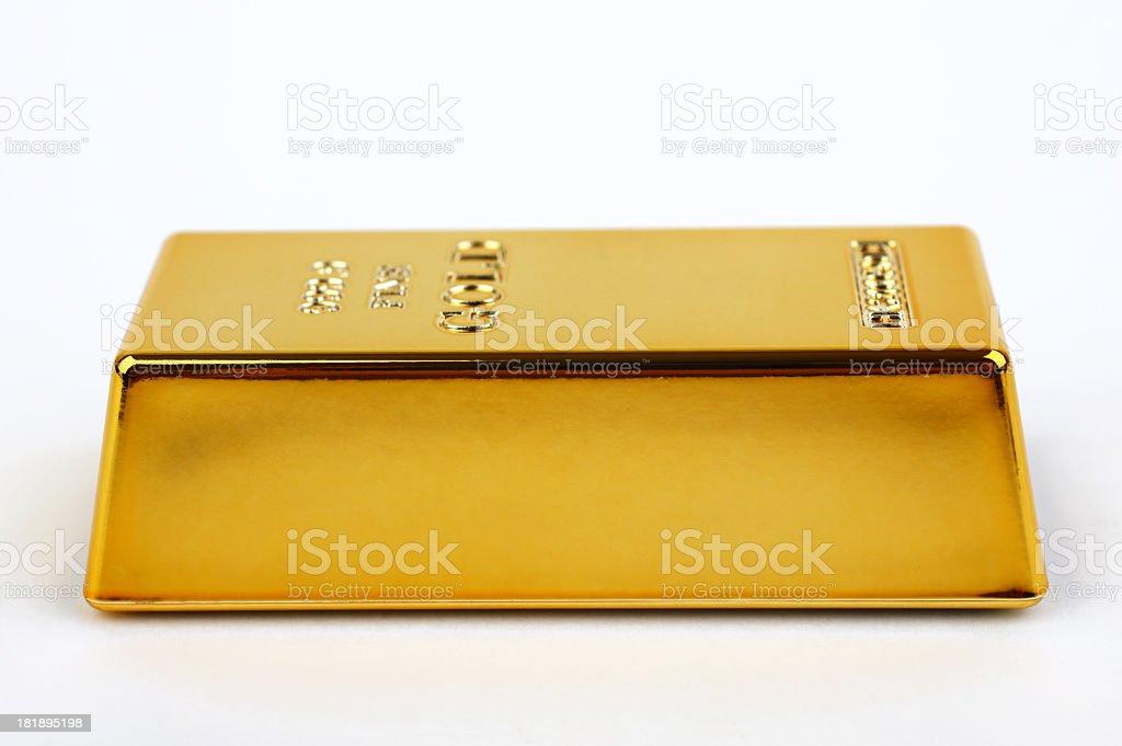 Bar of gold isolated on white background stock photo