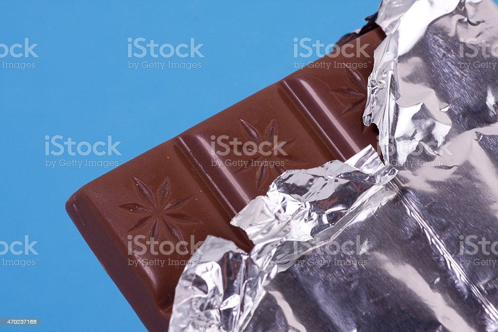 Bar of milk chocolate in sliver foil stock photo