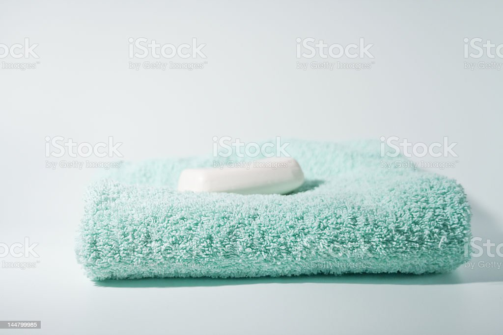 bar of soap and blue green towel stock photo
