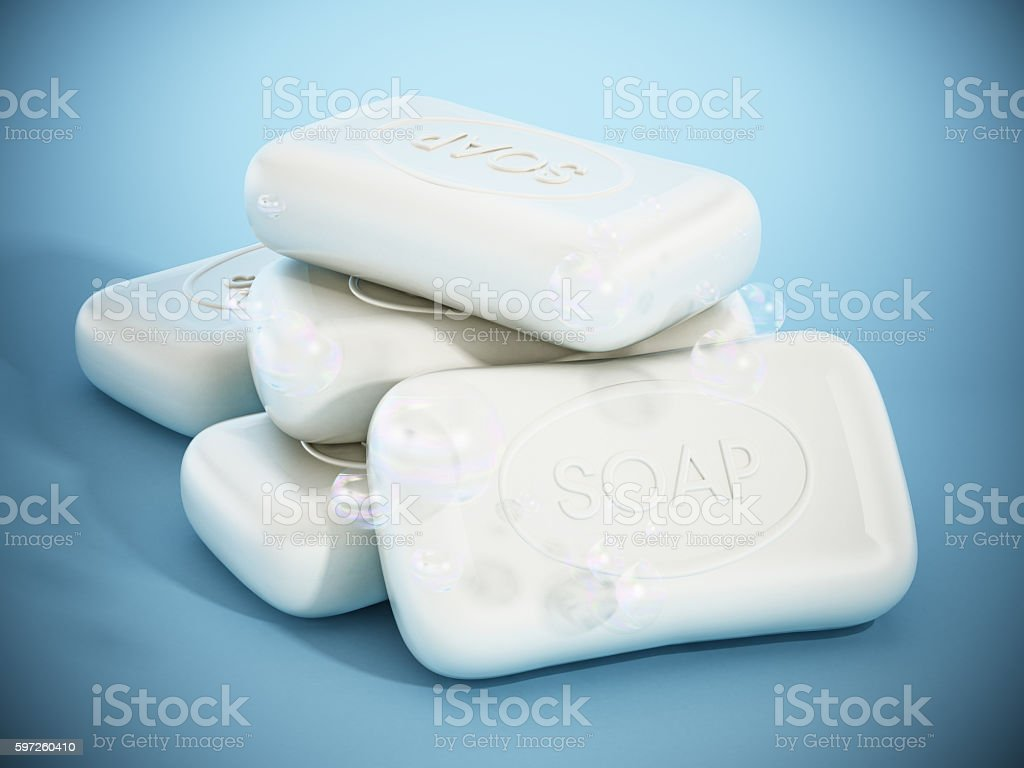 Bar of soaps standing on blue surface stock photo