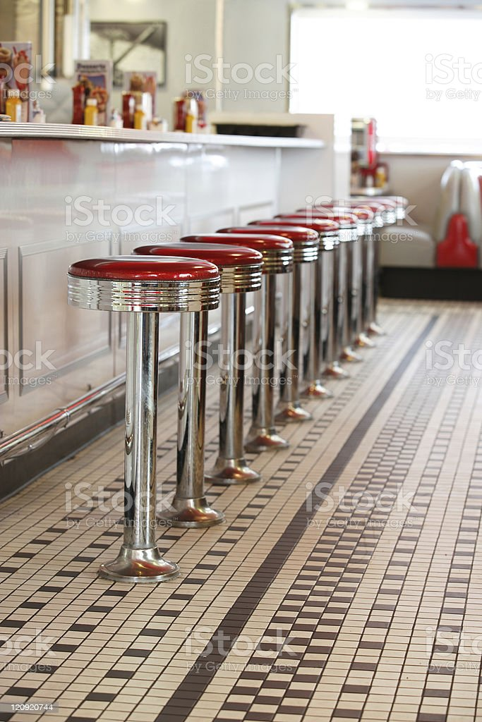 Bar stools in a diner stock photo