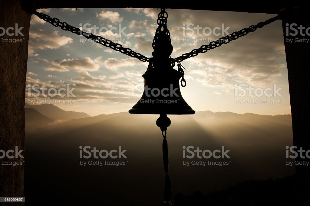 Baraha Temple bell at sunrise in Nepal. stock photo