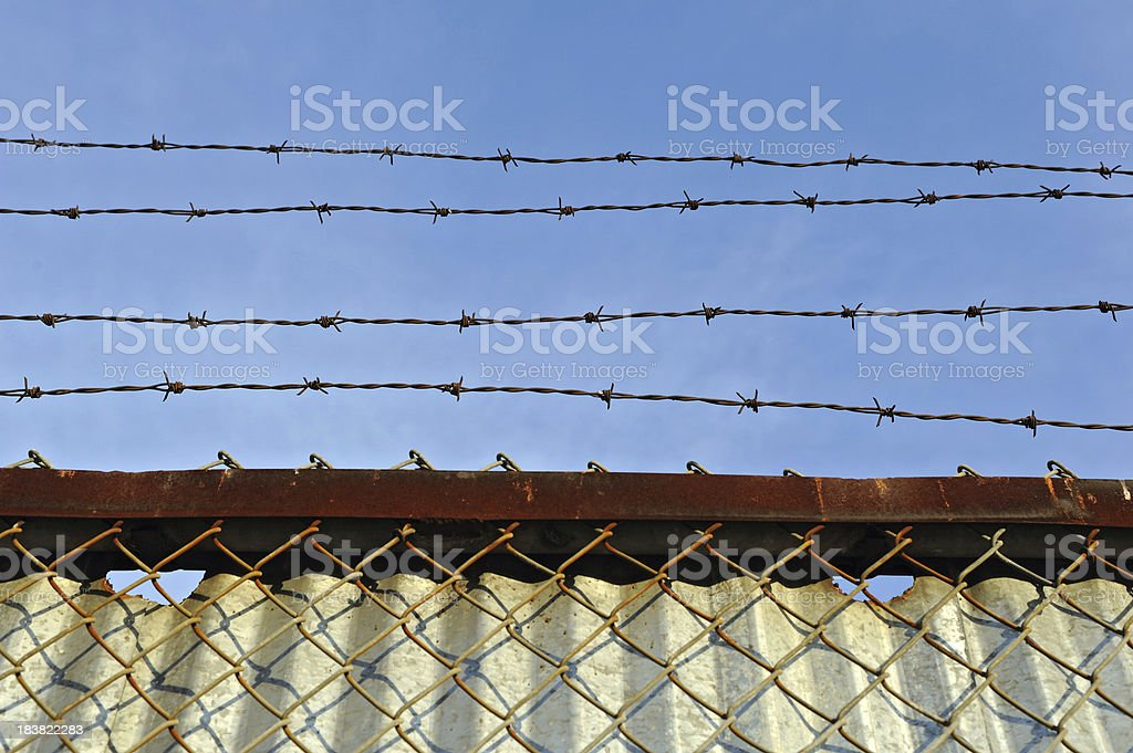 barb wire and fence royalty-free stock photo