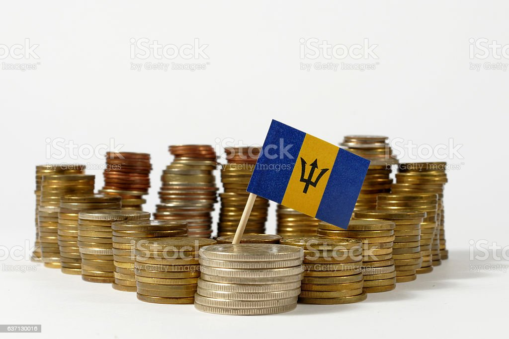 Barbados flag waving with stack of money coins stock photo