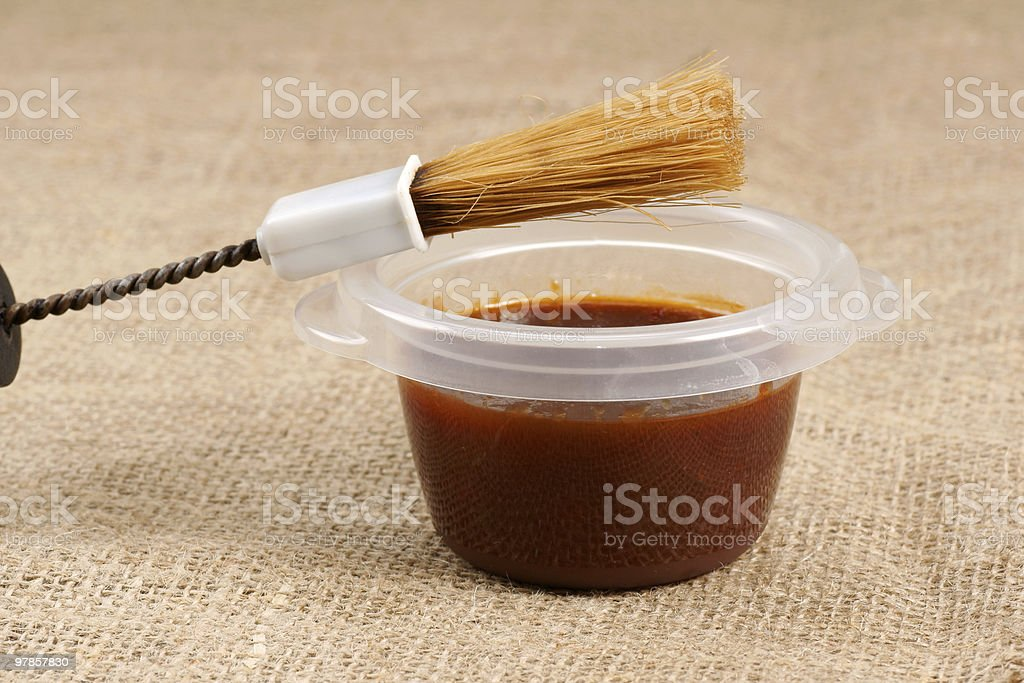 barbecue brush with sauce stock photo