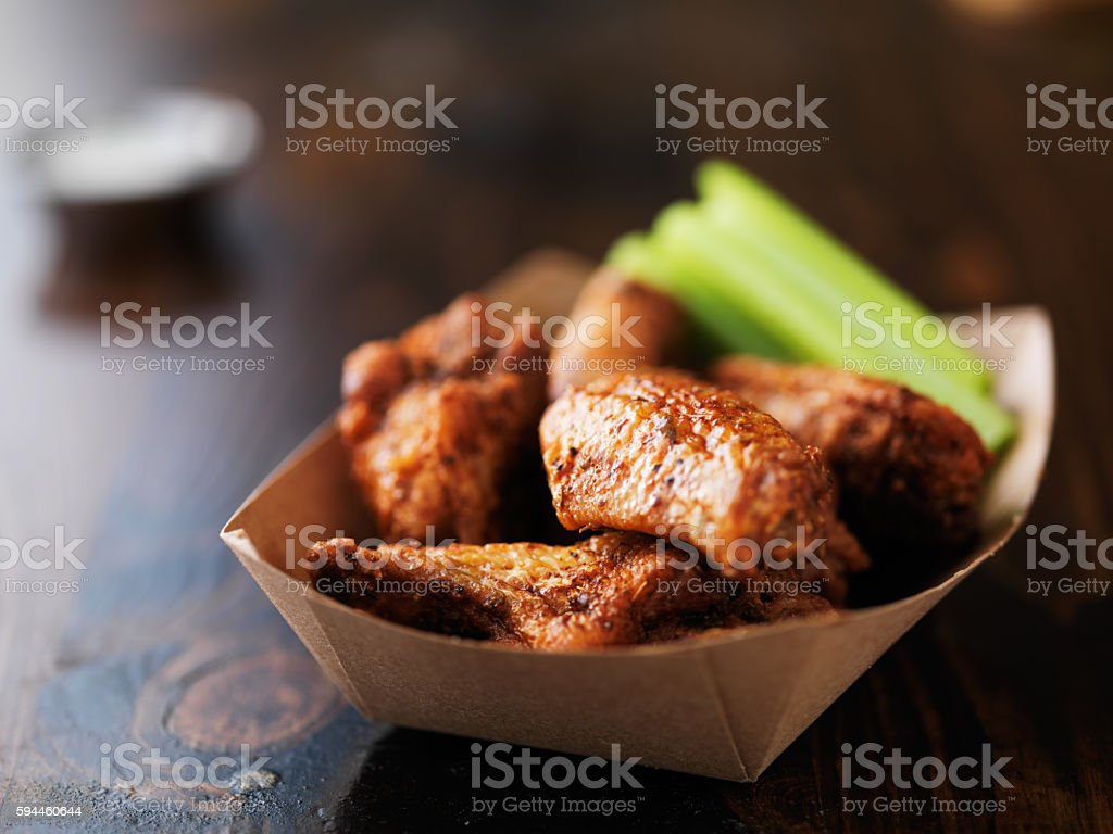 barbecue buffalo chicken wings in paper tray stock photo