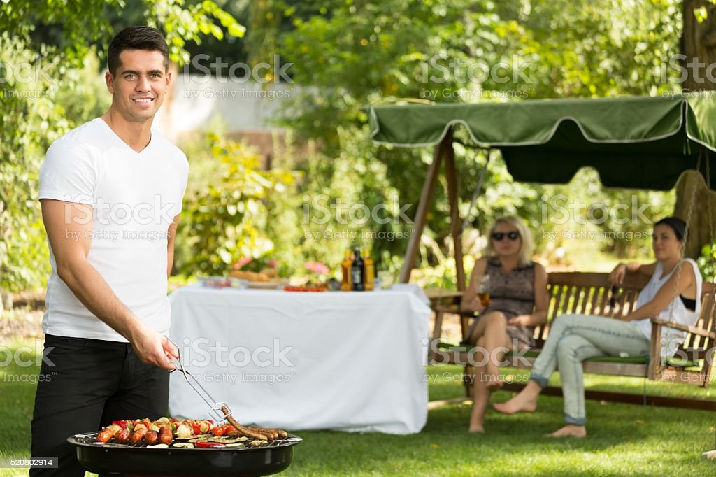 Barbecue chef in the garden stock photo