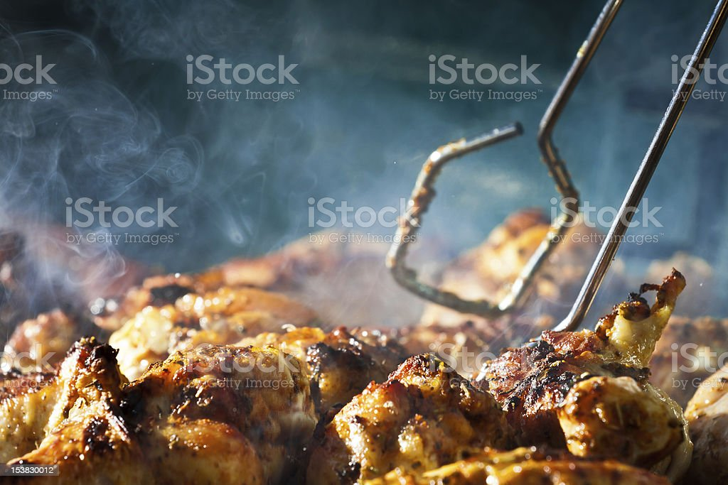 Barbecue chicken with cherbs on Grill stock photo