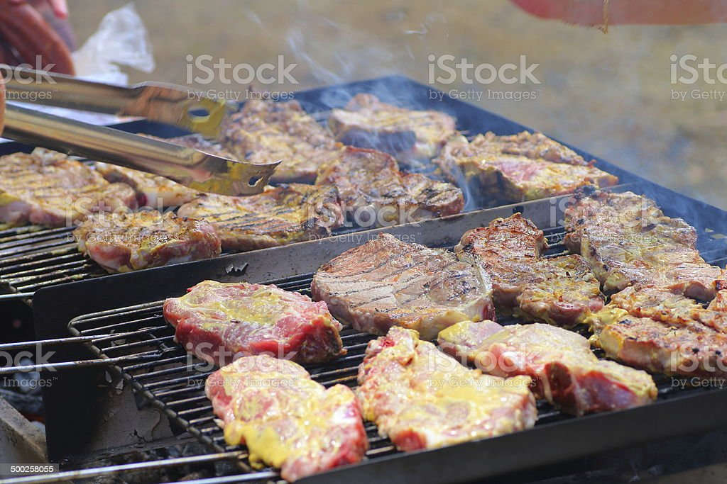 Barbecue cooking in summer royalty-free stock photo