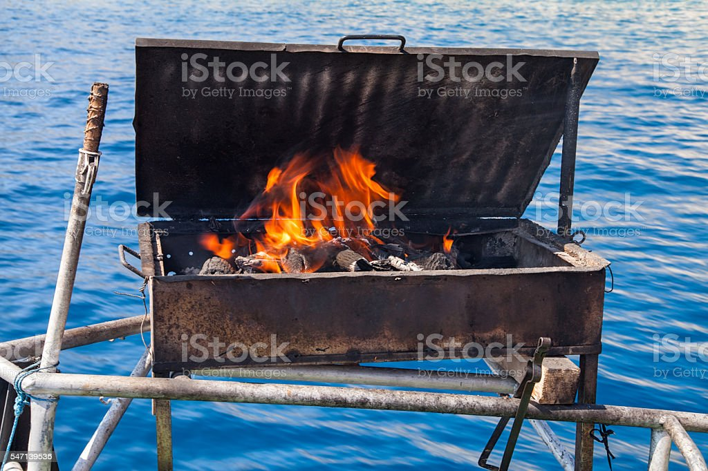 Barbecue fire grill on seaside stock photo