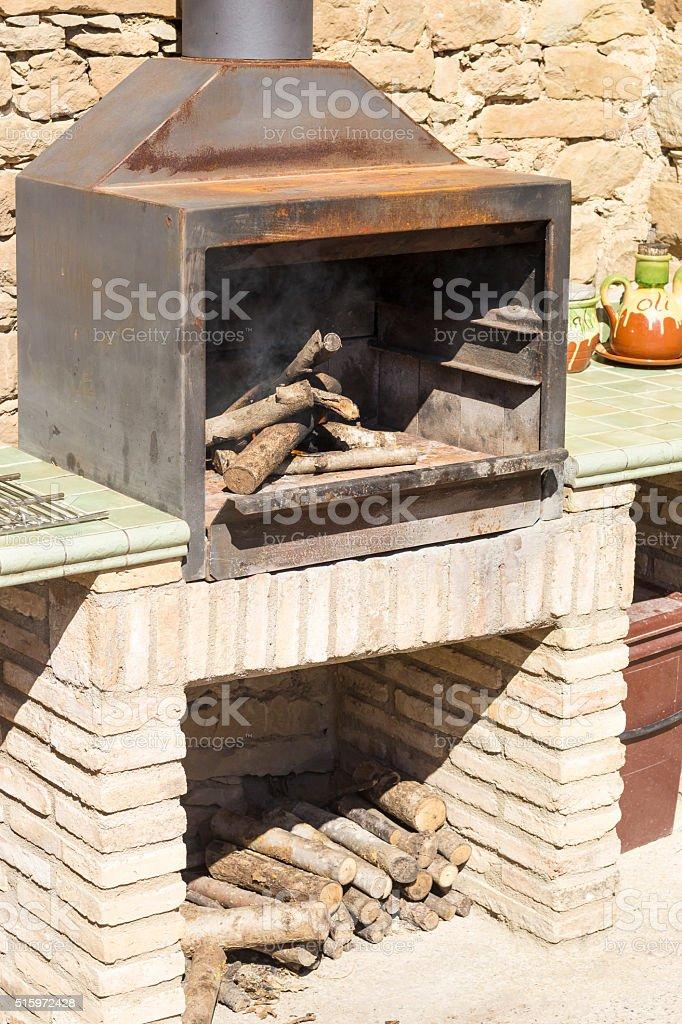 Barbecue Fire In A Stone Barbecue Set stock photo