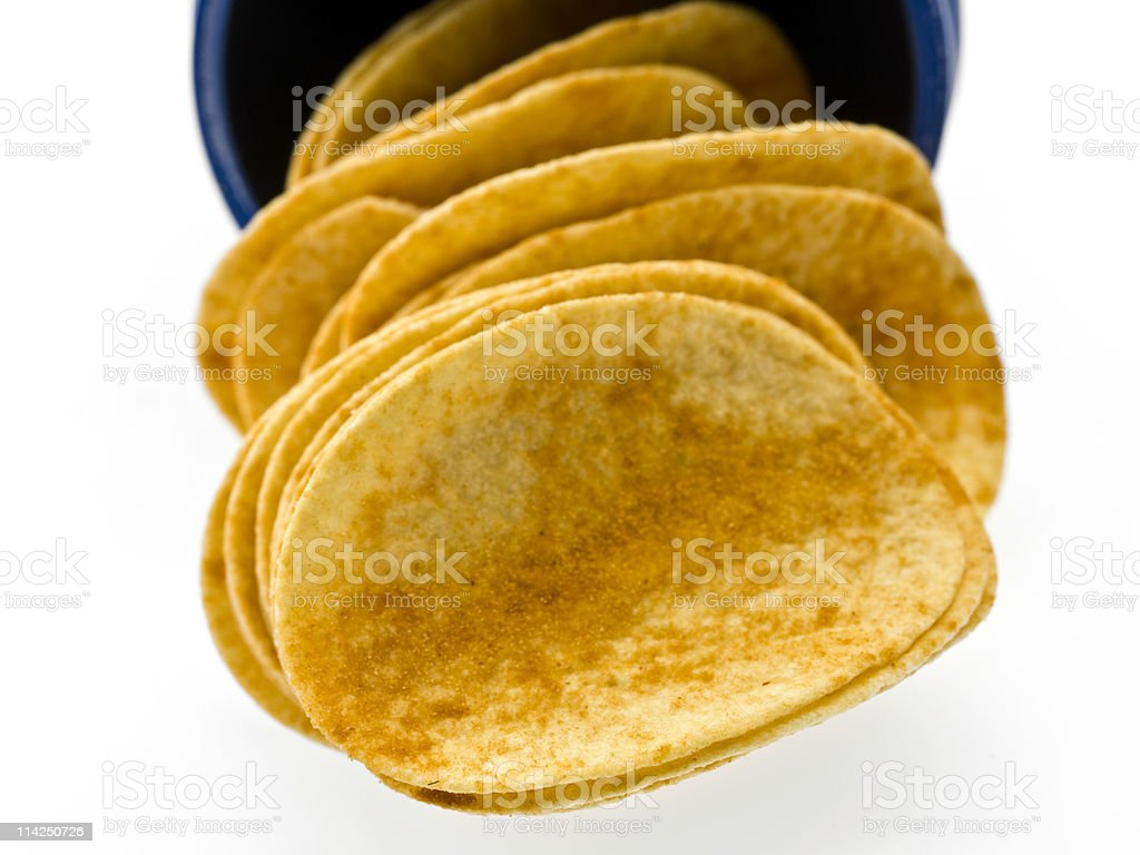 Barbecue flavored potato chips coming out of the can royalty-free stock photo