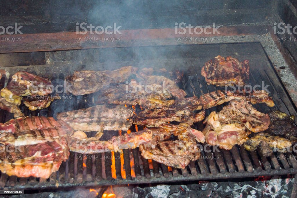 barbecue girll meat ,smoke up stock photo