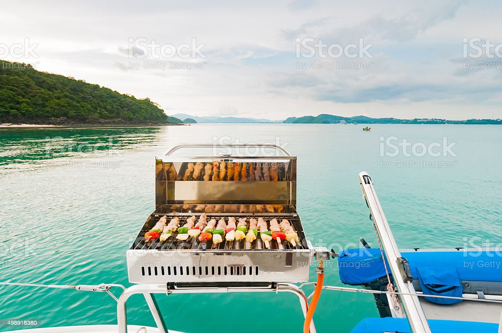 Barbecue grill on the boat. Luxury boat party in Phuket stock photo