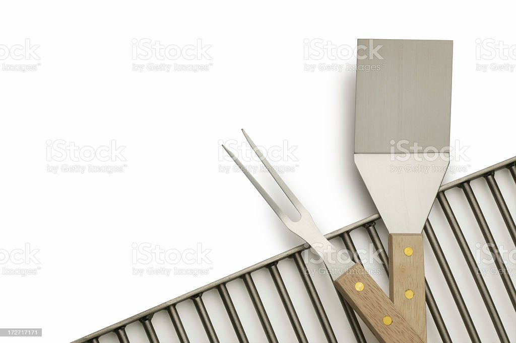 Barbecue grill, serving fork and spatula on white background stock photo